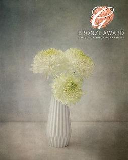 white flowers in vase 1 bronze september