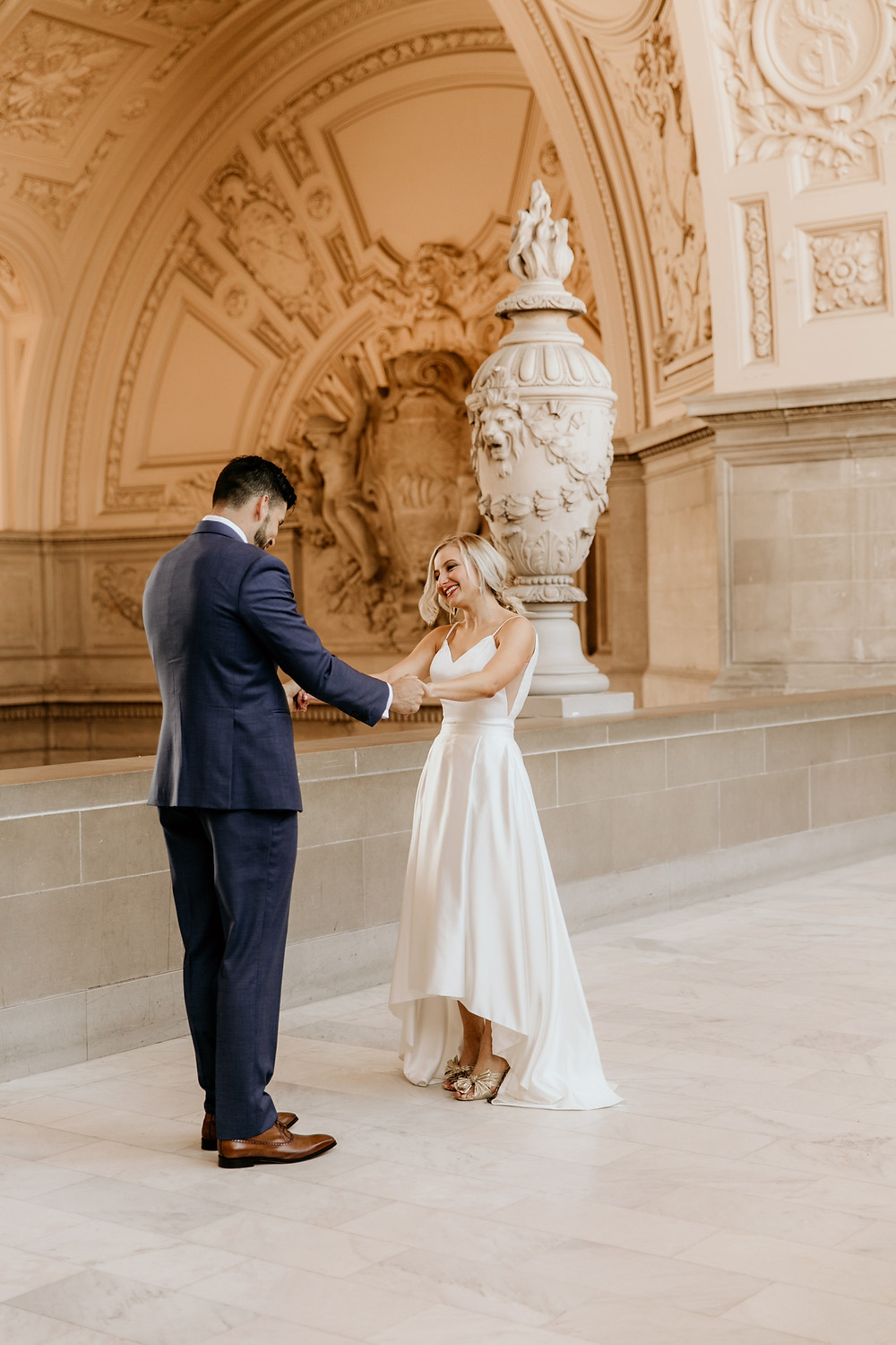 Destination San Francisco wedding planning at San Francisco City Hall in a chic, modern wedding dress