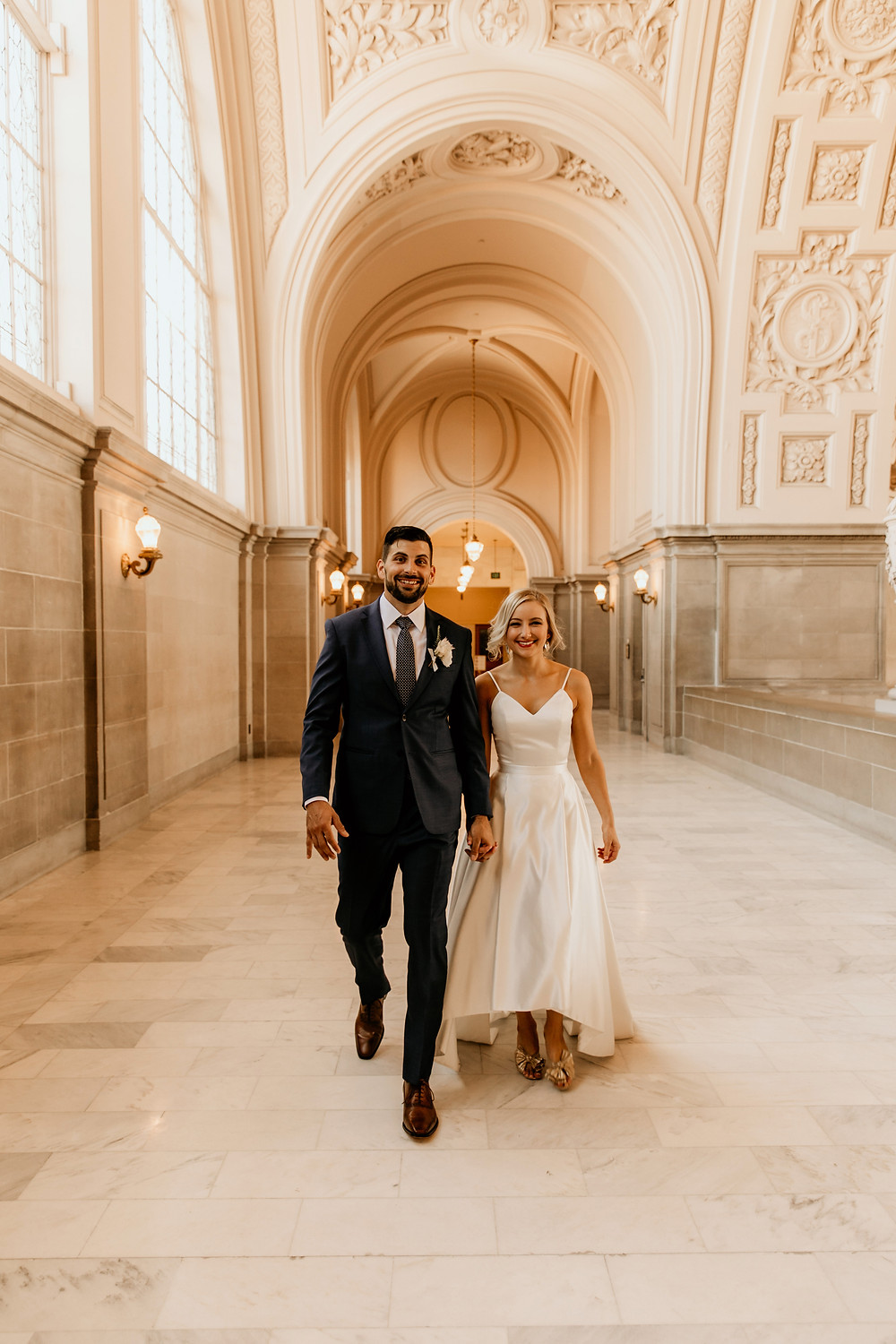 Wedding portraits at San Francisco City Hall before this chic city wedding ceremony.
