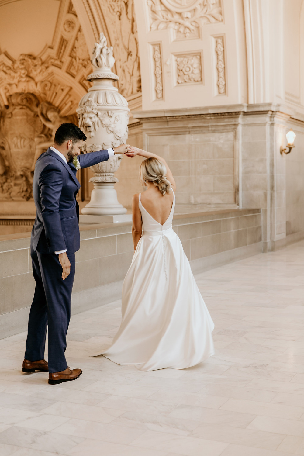 San Francisco city hall wedding, planned by destination wedding planner Liza Bagerman at Studio DBI. This modern and contemporary chic city wedding was full of custom details.