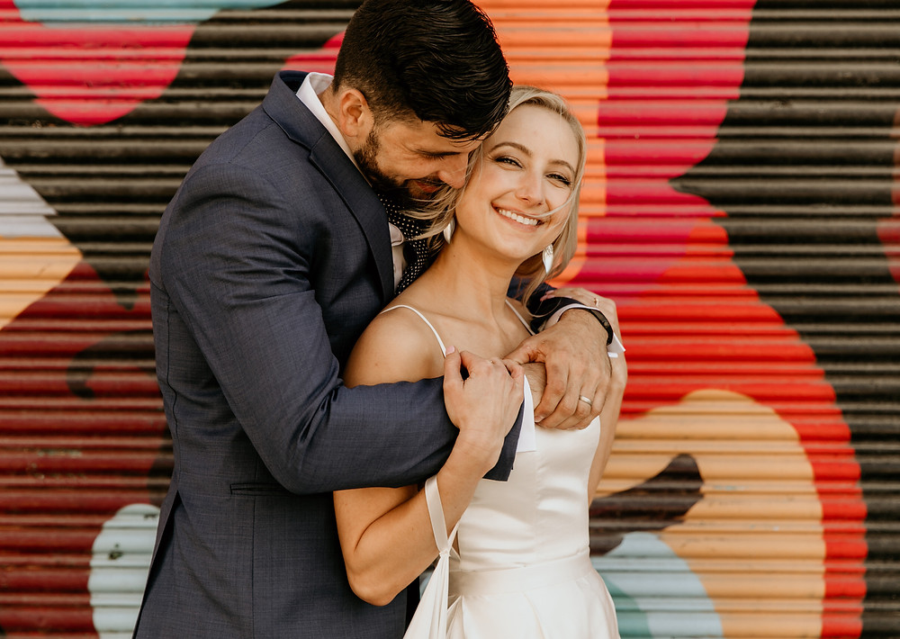 wedding portraits in front of san francisco street art for a modern chic san francisco wedding