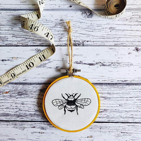 Freehand embroidered bee decorative hoop