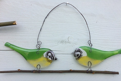 Pair of fused glass green birds on a twig