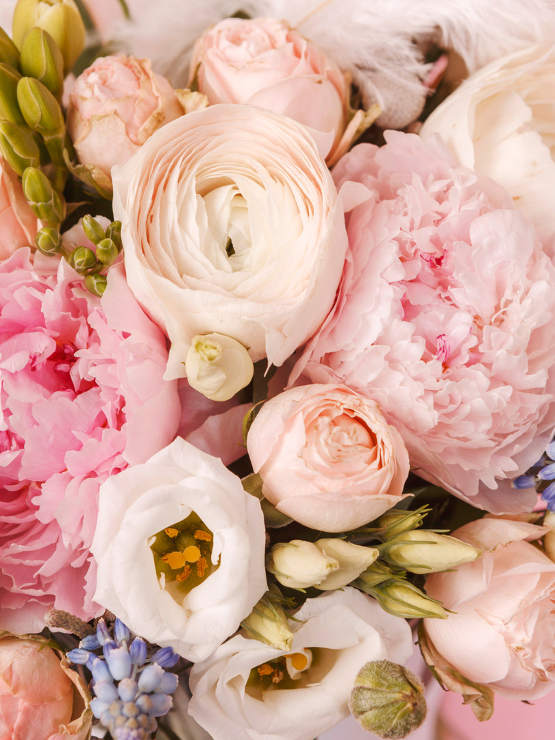 Peonies and ranunculus flower bouquet wi