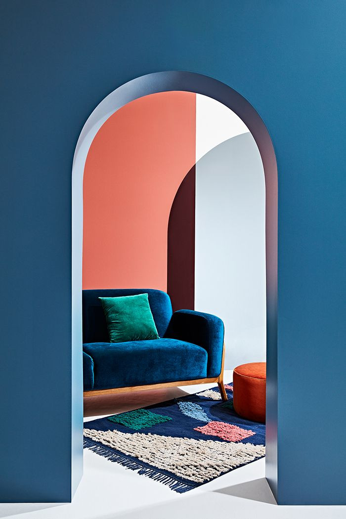 Creative ways to use paint around your home | Colour blocking example in a room with blue and coral paint | Seasons in Colour Interiors Blog