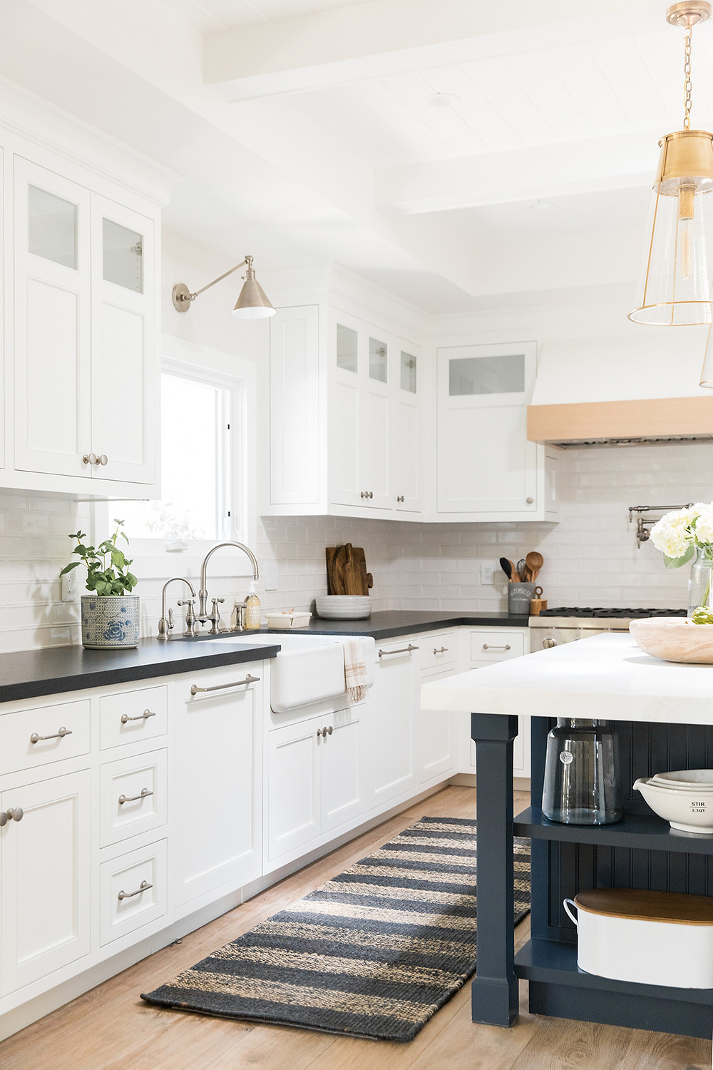 20 White Kitchen Design Ideas white cabinets in kitchen with striped runner in front of the sink