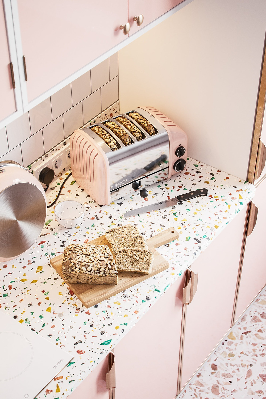 candy pink kitchen cabinets and tutti frutti terrazzo worktop