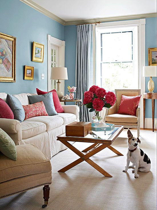 traditional english home with blue wall and pink cushions