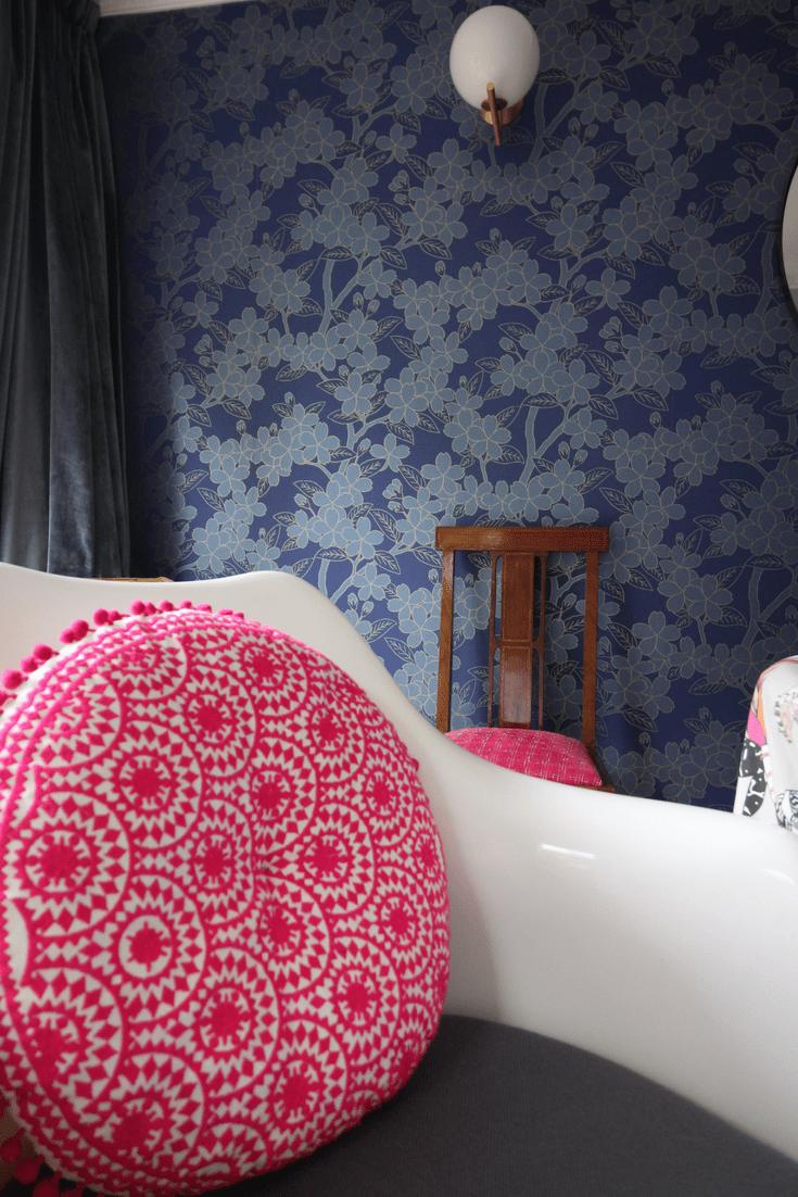 Camelia wallpaper Little Greene, tulip chair, Flos wall light, round mirror, dining room