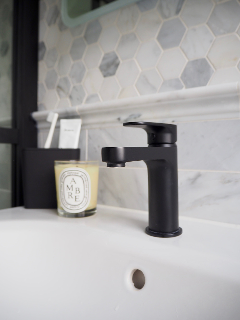 Methven Breeze Matt Black washbasin mixer tap and marble hexagon tiles from Mandarin Stone, VitrA Frame sink vanity