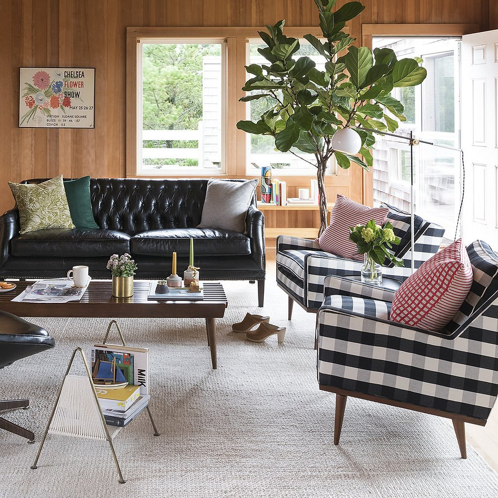 midcentury armchair with plaid fabric in black and white and black sofa fiddle leaf fig tree