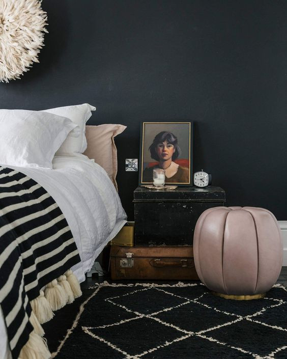 leather stool and pom pom blanket soho home