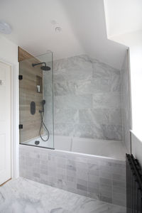 modern marble and wood bathroom with black accents. Black Bedroom Furniture Sets. Home Design Ideas