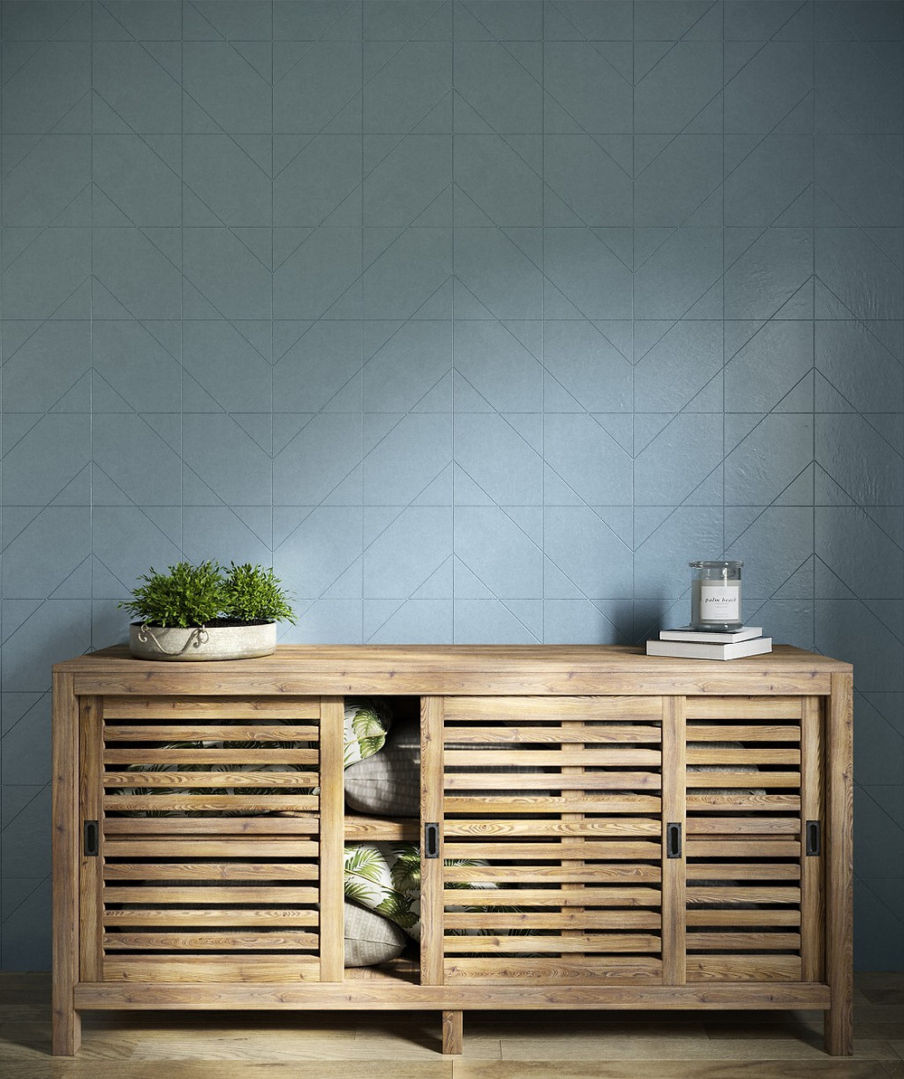 bathroom with blue wall tiles in chevron pattern and natural wood sideboard