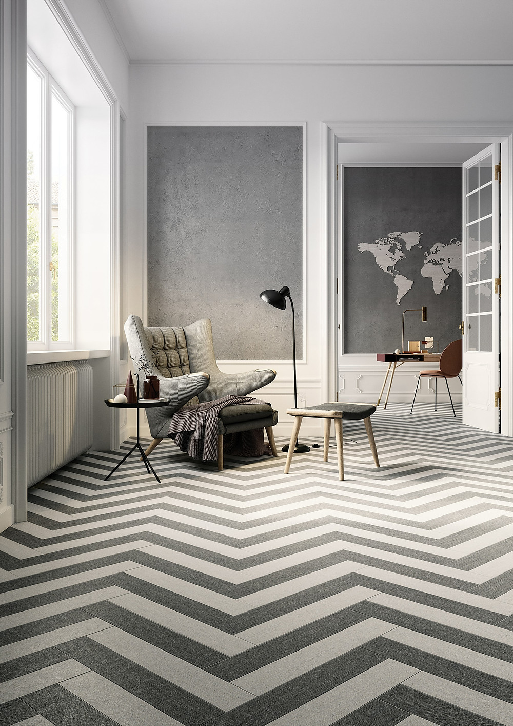 living room with herringbone or zig zag pattern tiles from Gemini Tiles, a papa bear chair and grey walls. Gubi Beetle chair in the background.