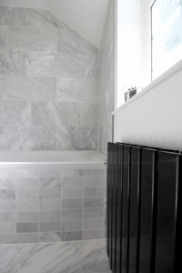 Modern Marble And Wood Bathroom With Black Accents