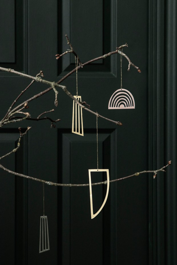 brass Christmas ornaments on a branch from Ferm Living