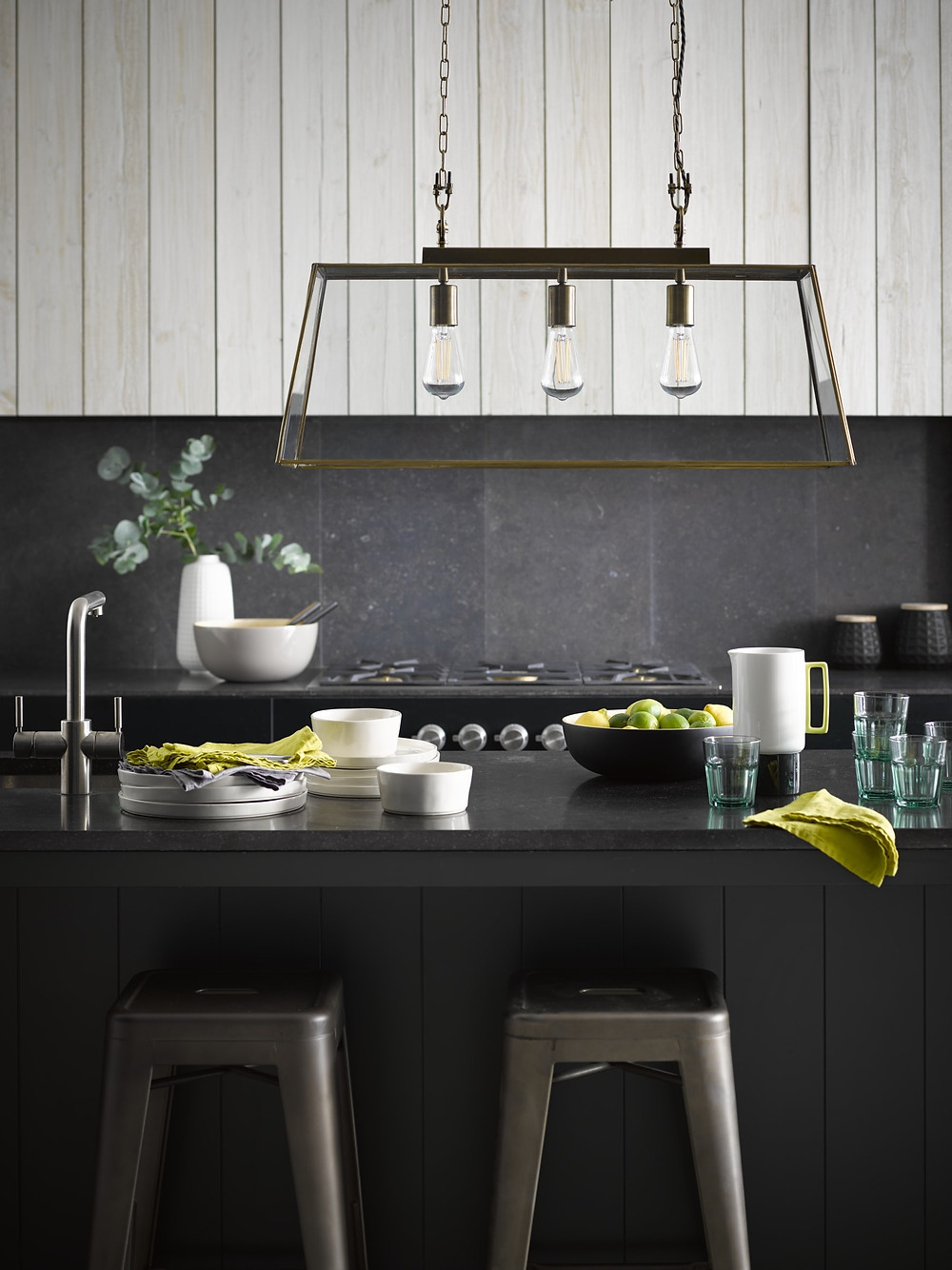 Pooky Luxor pendant light over kitchen island in a black kitchen