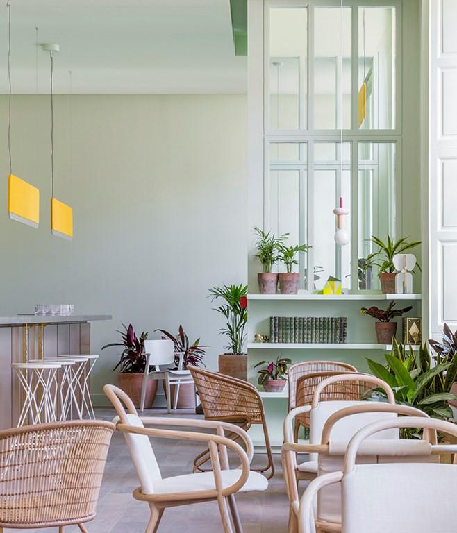 EDEN LOCKE HOTEL interior decor lounge with rattan chairs