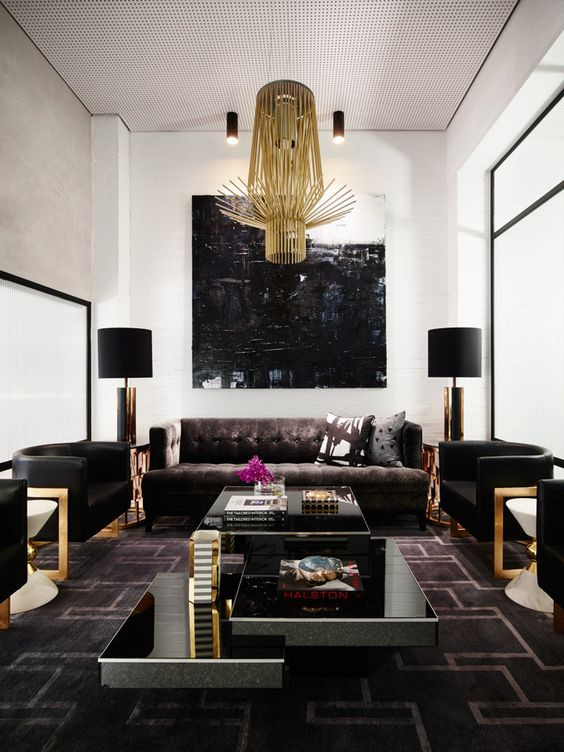 Hollywood regency interiors by Greg Natale with accent chairs and abstract art statement lights