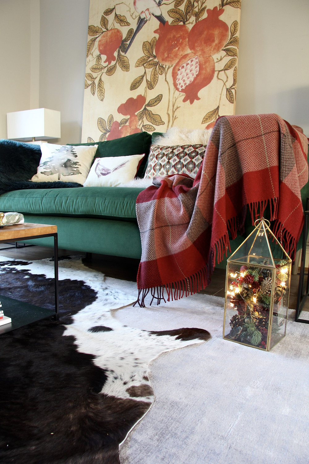 Living room decor ideas for Christmas. Highland Check 100% Wool Throw over the green EDEN sofa from the Sofa Workshop. Grey rug with cowhide over it.