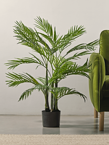 Faux Short Palm next to a green chair