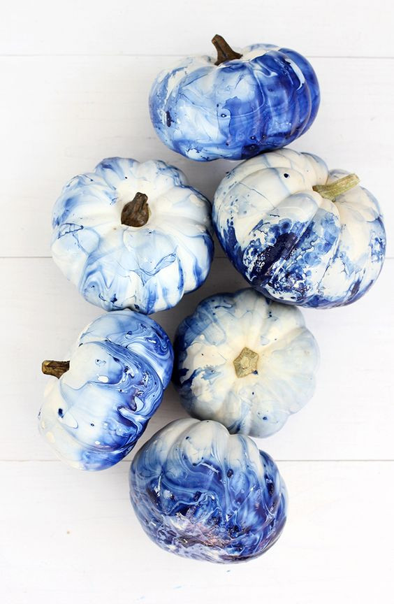 marbled indigo pumpkins that have been dip dyed in nail polish
