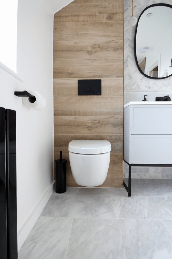 Small bathroom design ideas with marble floor, built in shower bath, black radiator and wood effect tiles, spa bathroom decor, Vitra wall hang toilet and Lusso Stone PIANA 1000 vanity, Black toilet roll holder and marble herringbone mosaic