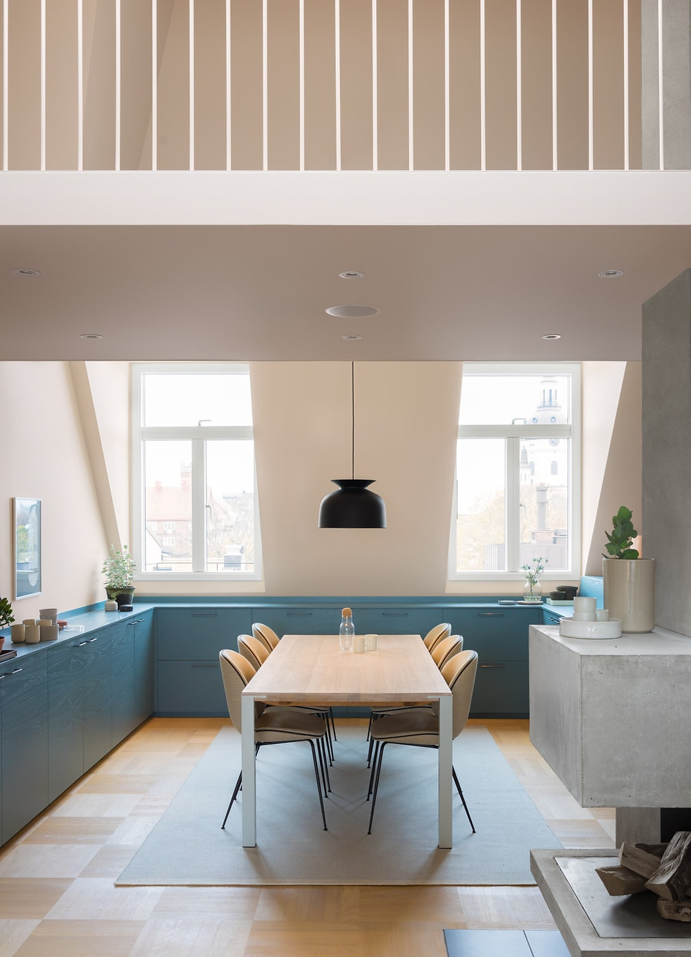 kitchen with blue cupboards and pink peach walls