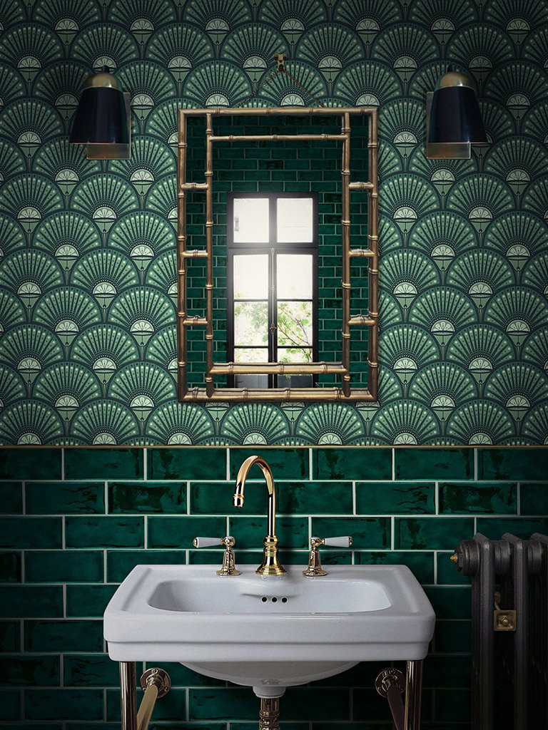 ART DECO style wallpaper in arsenic green from Divine Savages and a gold bamboo mirror, above glass green metro tiles with white grout and a victorian style sink
