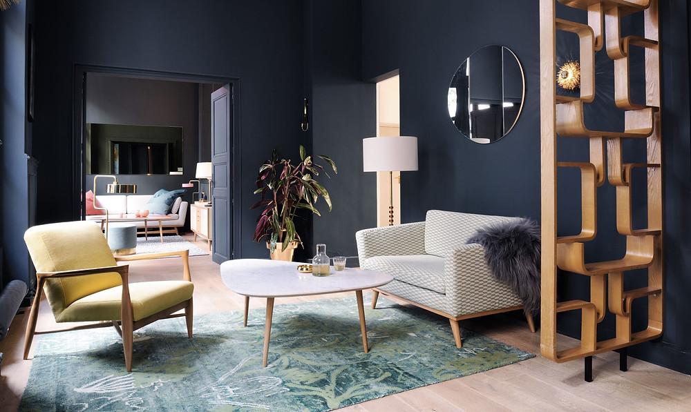 mid century styled living room dark walls