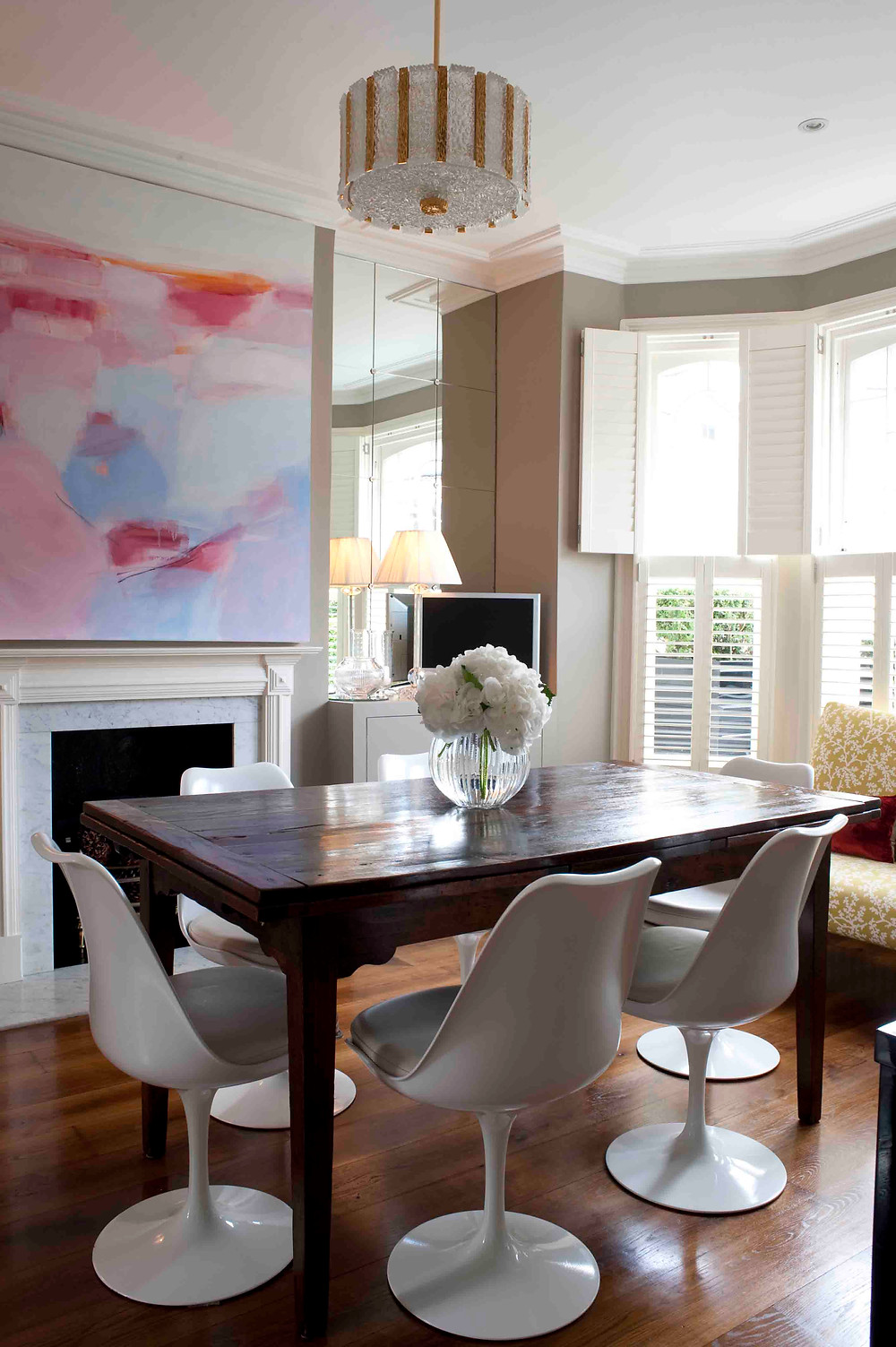 taupe walls in the dining room with antique dining table and saarinen tulip chairs, abstract art, Sarah Vanrenen