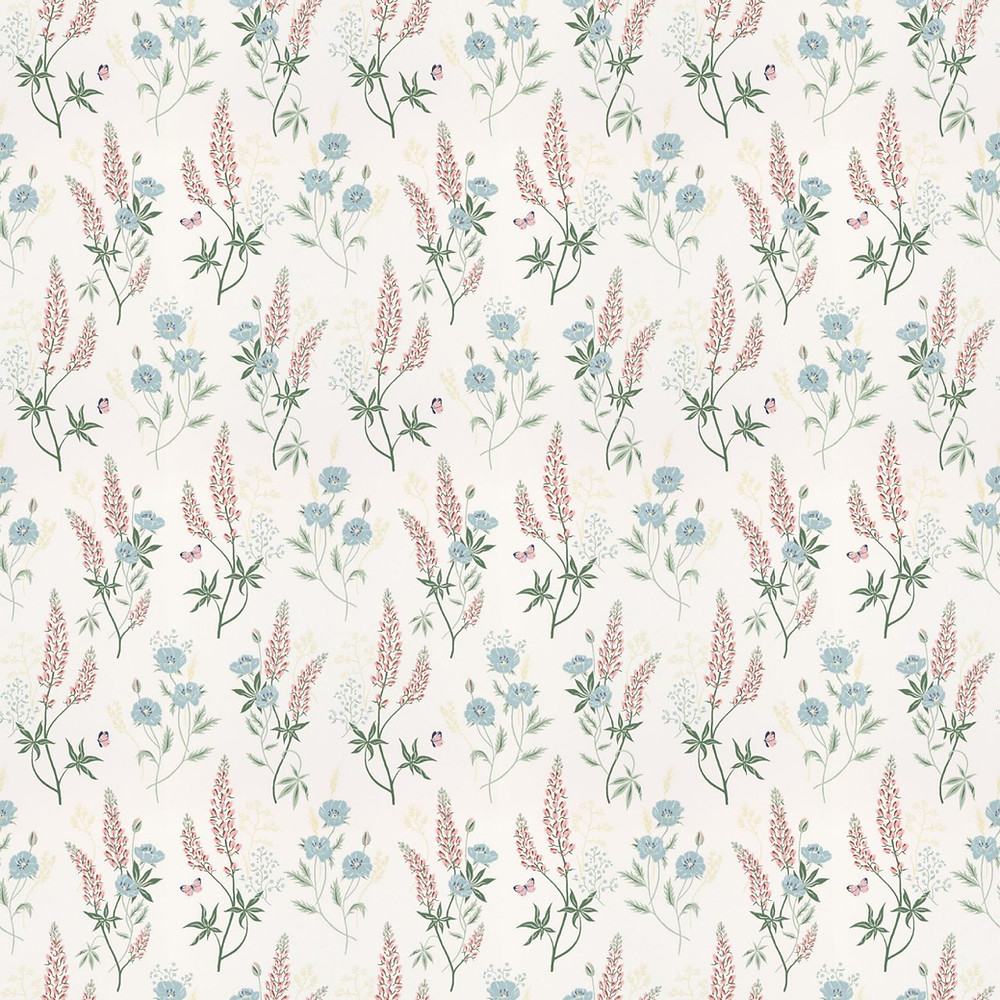 A flowering summer meadow with tall lupines and poppies flowing over the wallpaper. A cool colourway of pink, green and blue on a white background. Design: Sara Bergqvist