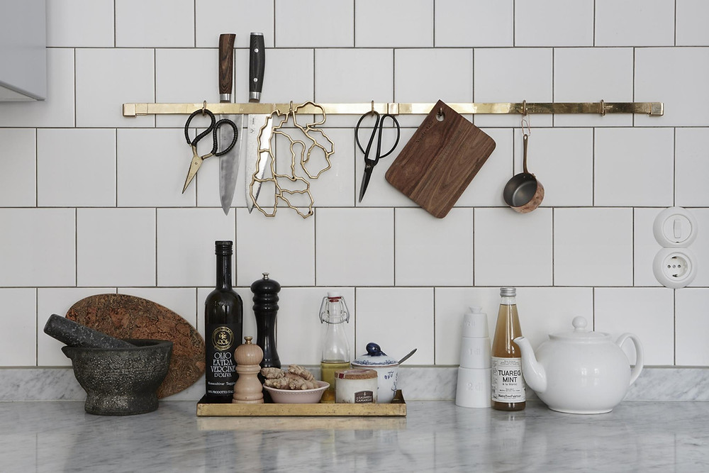 Scandinavian interior design kitchen decor with square tiles and retro fridge, off grey cabinets with brass handles