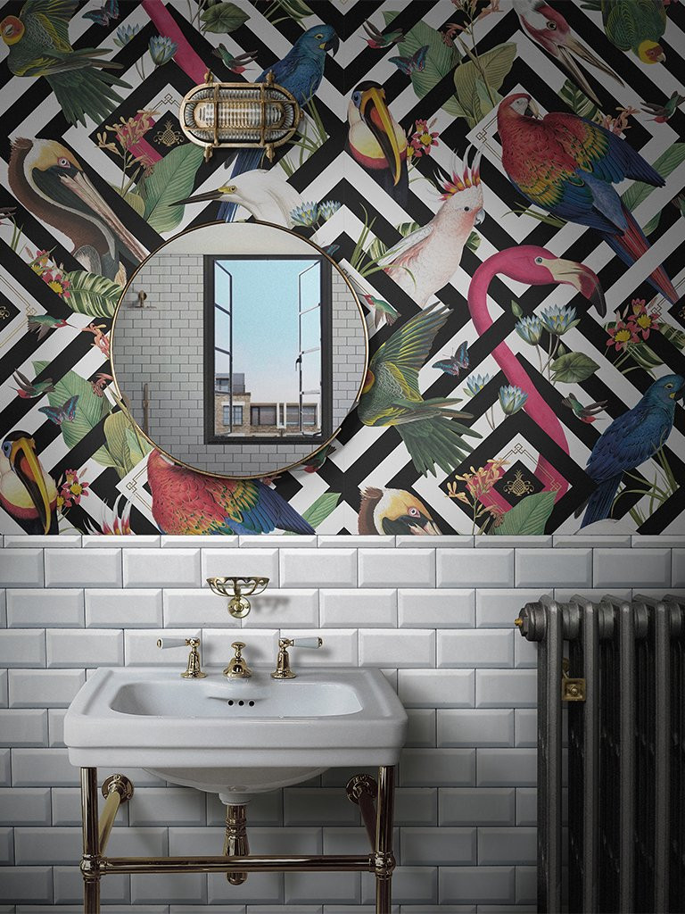 Birds and geometric print in black and white from divine savages, tropical, eclectic above metro tiles in white and a victorian style sink