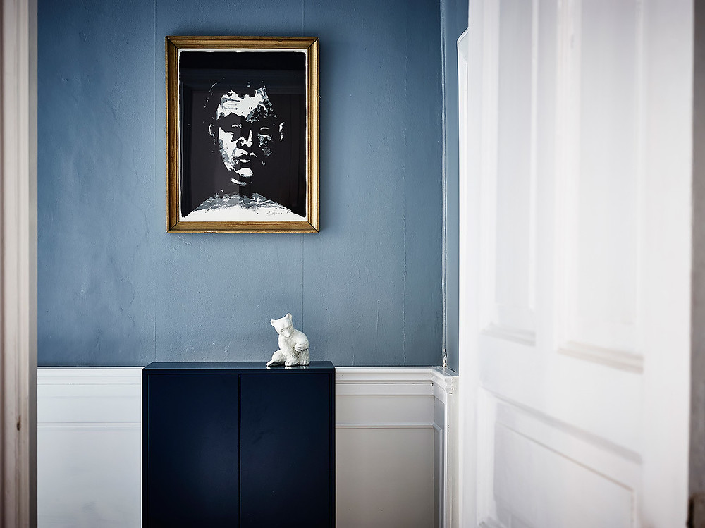 blue walls in hallways with white panelling