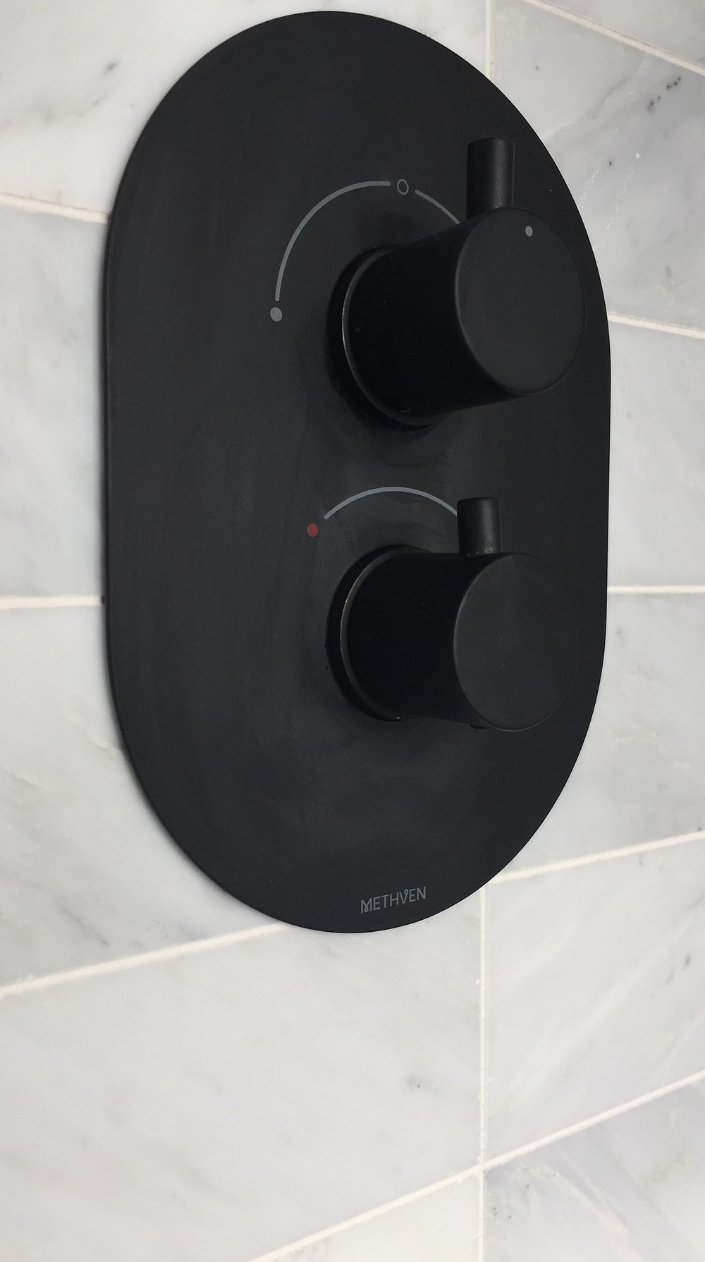 Methven KAHA Black shower 2 WAY mixer valve and marble hexagon tiles from Mandarin Stone