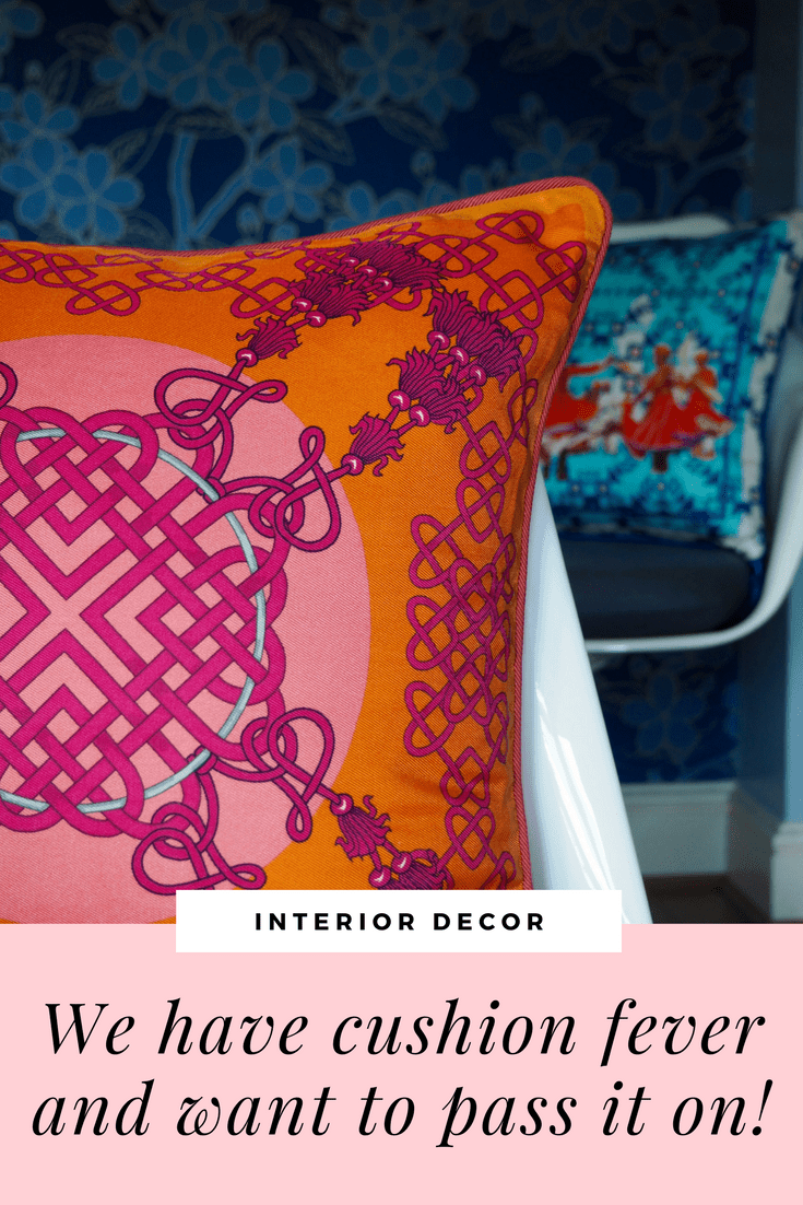 pink and orange cushion by BIVAIN in silk twill in a blue background and on a tulip chair