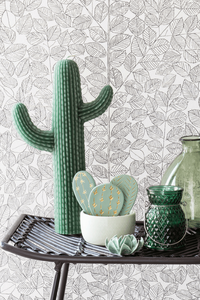 a vignette with leafy wallpaper and green decorative accessories