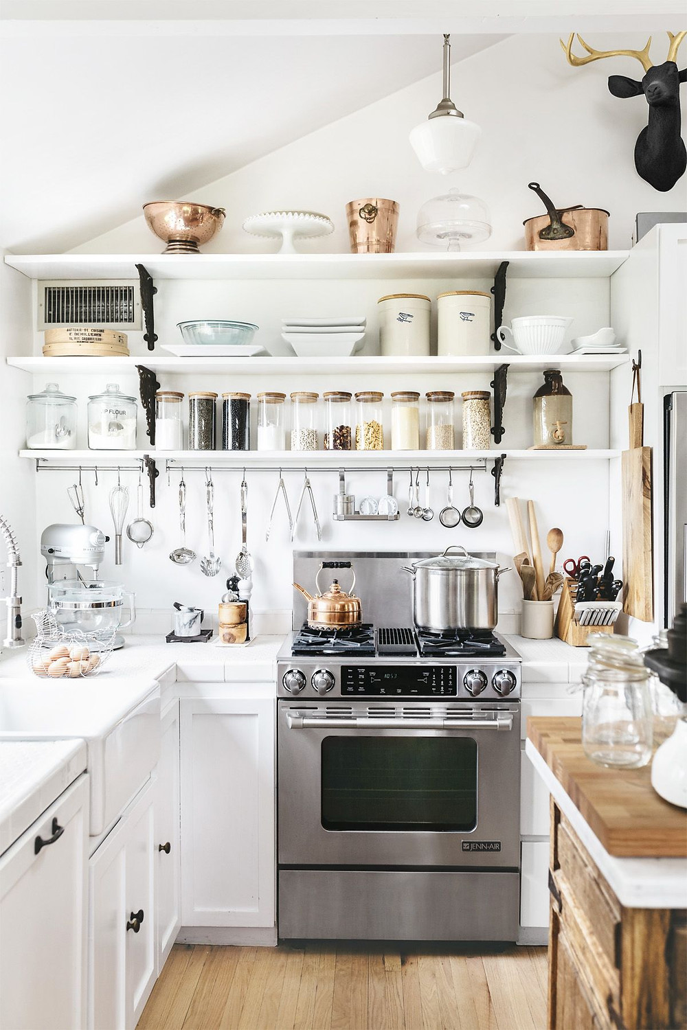 all white kitchen farmhouse chic with open shelving and copper pots
