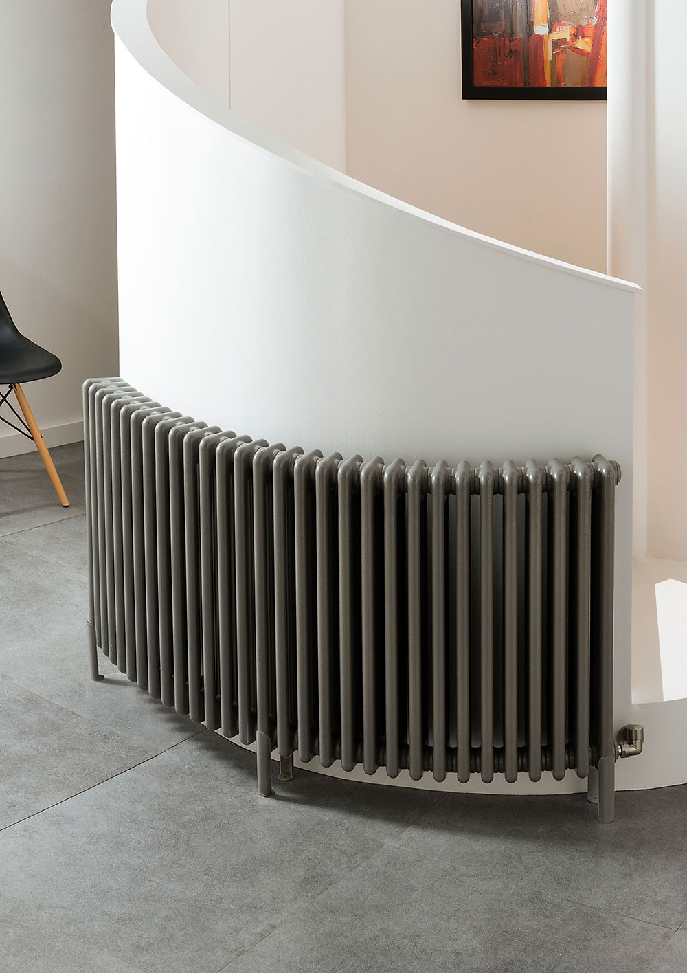 curved radiator framing a wall around a staircase