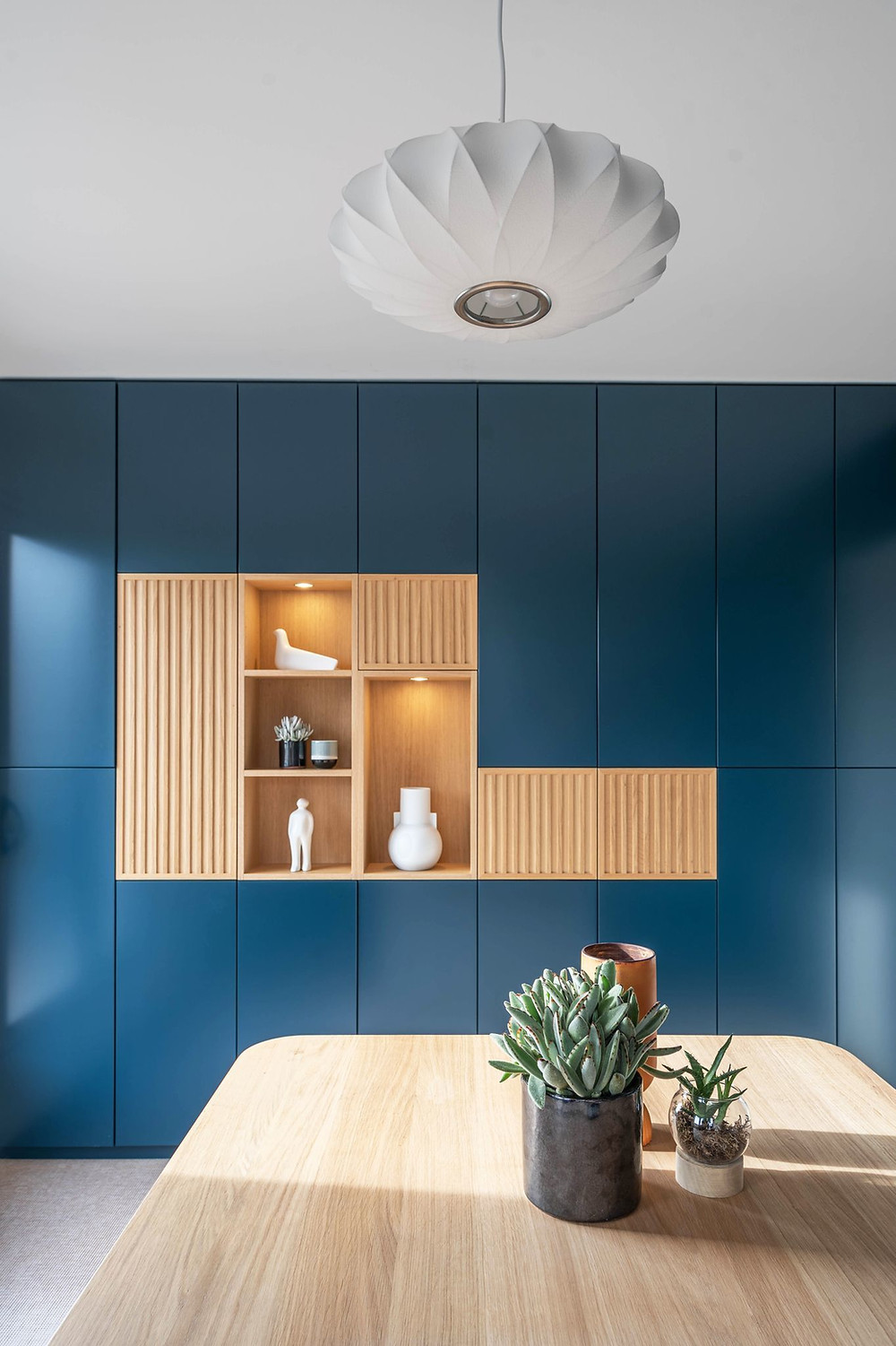 Wall to wall storage in blue colour with oak insert shelving