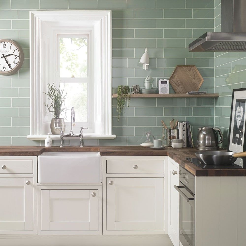 pastel coloured kitchen tiles in pistachio with cream cabinetry and large farmhouse sink