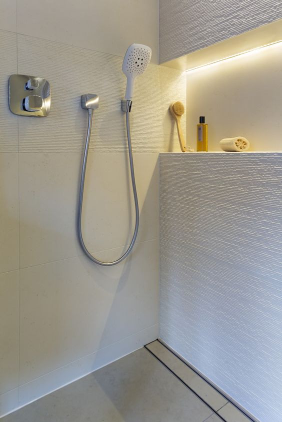 recessed task lights in the bathroom are ideally placed over the mirror or in a wall recess in the shower.