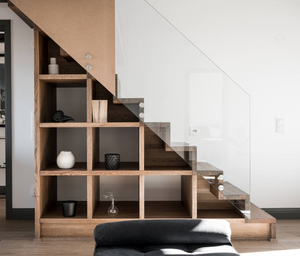 Contemporary staircase with storage under the steps and glass