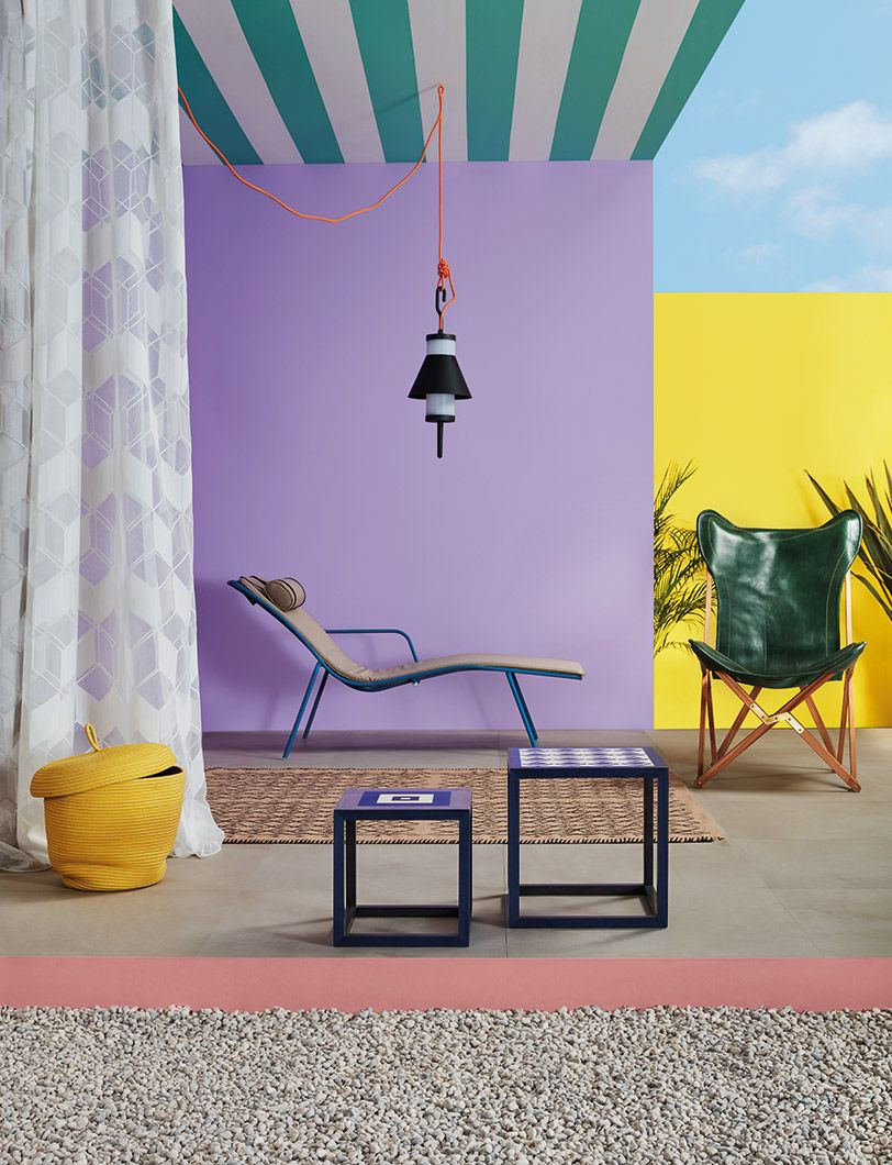 Creative ways to use paint around your home | Green stripes painted on a ceiling in an outdoors space with lilac wall | Seasons in Colour Interiors Blog