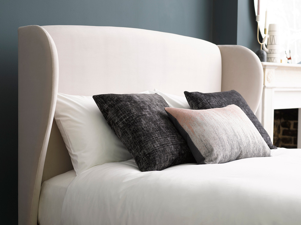 Bedroom trends that will dominate 2019. Lupin, by Button & Sprung in cream. Angled headboard. Bedroom decor tips.