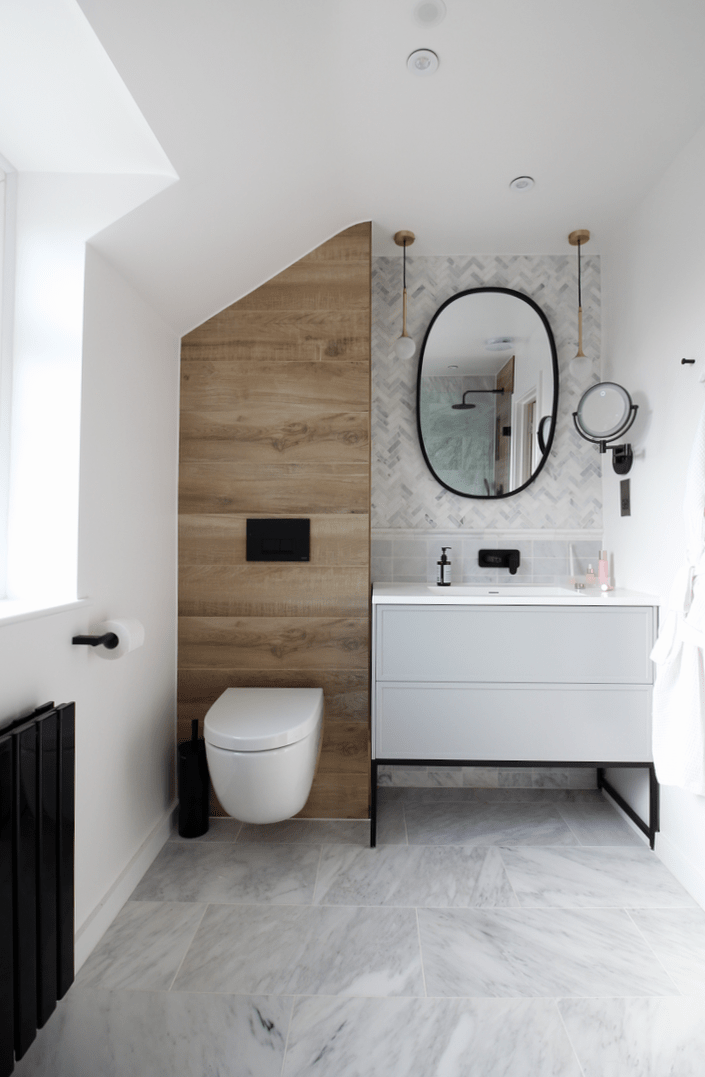 Small bathroom design ideas with marble floor, built in shower bath, black radiator and wood effect tiles, spa bathroom decor, Vitra wall hang toilet and Lusso Stone PIANA 1000 vanity
