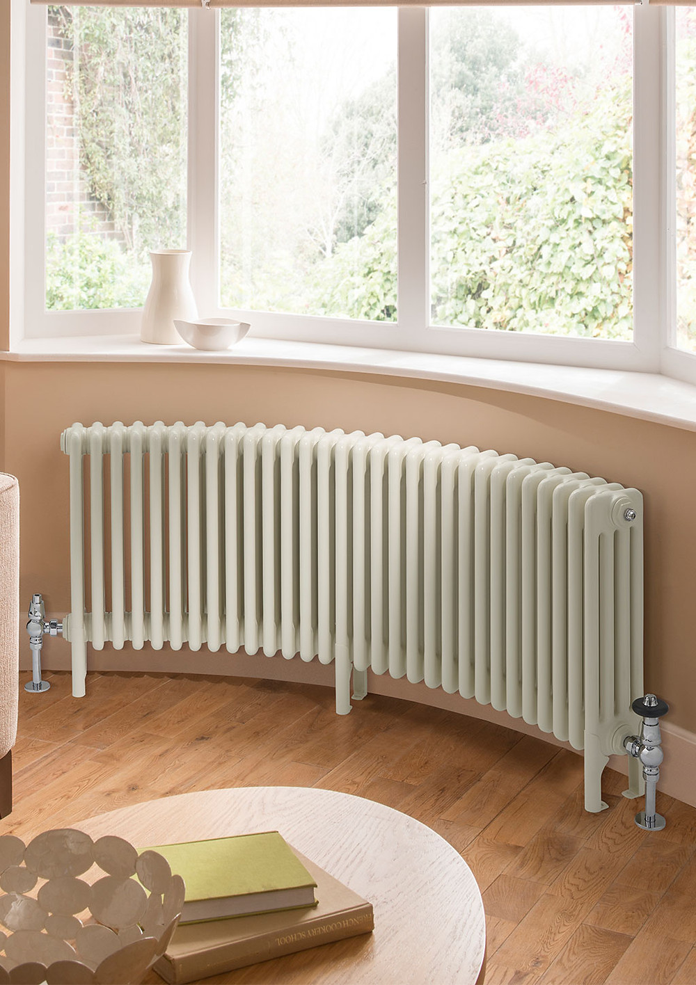 curved radiator under a window