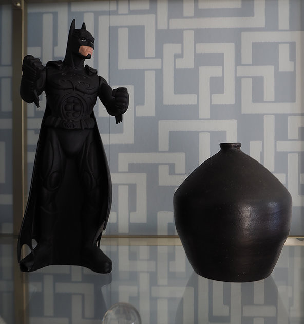 batman toy and black vase enigma wallpaper farrow and ball